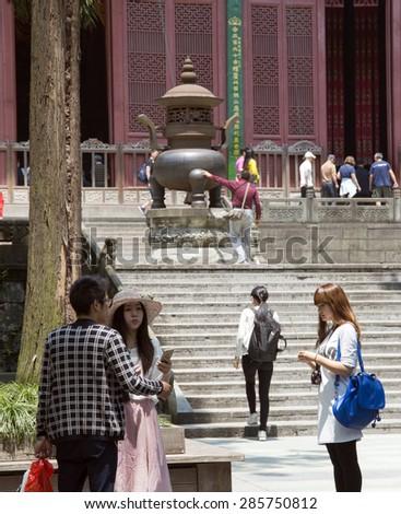 HANGZHOU, CHINA - MAY 4, 2015: Chinese tourists at the Lingyin Temple, a Buddhist temple of the Chan sect located north-west of Hangzhou, Zhejiang Province, and important landmark. - stock photo