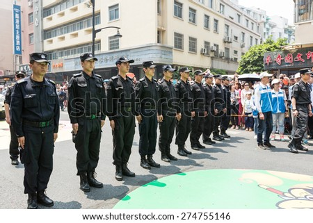 Hangzhou, China - May 1, 2015:The Eleventh China International Animation Festival ,hangzhou held  float parade and variety performance. Security personnel at the scene to keep order