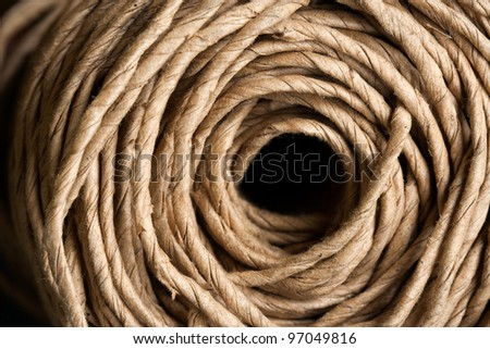 Hank of rope. Side view. Can be used as a nice background with sharp details. The rope is used in gardening. Colored version - stock photo