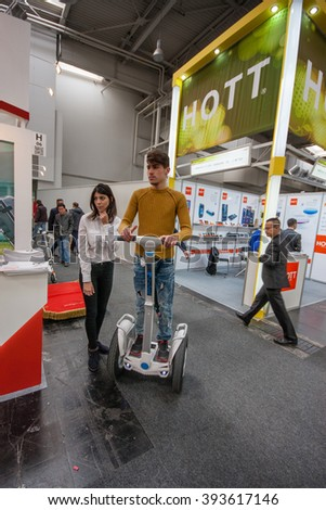 HANNOVER, GERMANY - MARCH 14, 2016: Attendee tests Segway displayed at CeBIT information technology trade show in Hannover, Germany on March 14, 2016. - stock photo