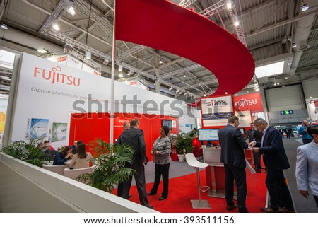 HANNOVER, GERMANY - MARCH 14, 2016: Booth of Fujitsu company at CeBIT information technology trade show in Hannover, Germany on March 14, 2016. - stock photo