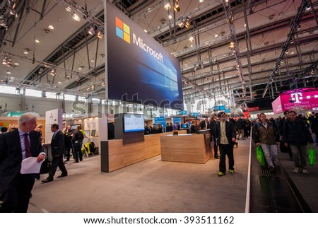 HANNOVER, GERMANY - MARCH 14, 2016: Booth of Microsoft company at CeBIT information technology trade show in Hannover, Germany on March 14, 2016. - stock photo