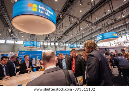 HANNOVER, GERMANY - MARCH 14, 2016: Lumia stand in booth of Microsoft company at CeBIT information technology trade show in Hannover, Germany on March 14, 2016. - stock photo