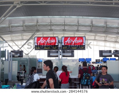 HANOI - MAY 26: Check-in counter of AirAsia at the new terminal(T2) of Noi Bai International Airport in Hanoi, Vietnam on May 26, 2015. AirAsia is a pioneer of low-cost airline in Asia.