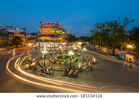 HANOI - September 14: Biggest trade centre of old Hanoi in Vietnam, on September 14, 2013. Hanoi is the biggest city in Vietnam and most popular Vietnamese city for many tourists from all the world - stock photo