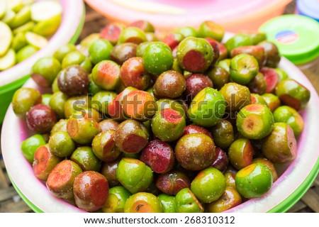 Hanoi street food, pickle fresh plum fruit - stock photo