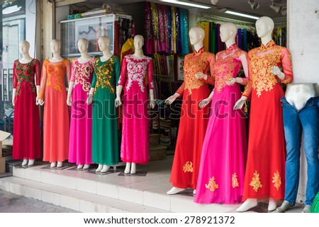 Hanoi, Vietnam - Apr 28, 2015: Vietnamese traditional dress Ao Dai for sale in a shop in Xuan Thuy street