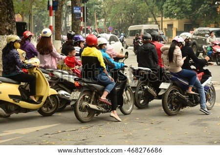 HANOI, VIETNAM - APRIL 4: motorcycles at traffic lights on April 4, 2016 in Hanoi, Vietnam. Hanoi has one of the highest motorcycle modal share rates of any city in the world.