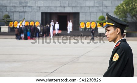 Hanoi, Vietnam - Dec 17, 2016: Vietnamese security police officer guarding in front of the tomb of late president Ho Chi Minh (Uncle Ho) in Hanoi capital.