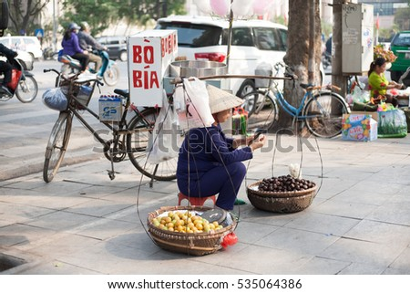 Hanoi Vietnam December 10 2016 Life in Vietnam- Hanoi,Vietnam Street vendors in Hanoi's Old Quarter. Street vendors sell a lot of things, fruits, flowers, personal items, etc..