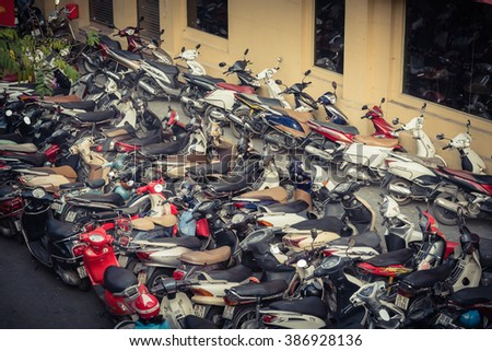 HANOI, VIETNAM-FEB 14,2016:Top view of a cramped parking lot with varieties of motorcycles brands in downtown at sunset.Vietnam is the world second highest motorcycle-owning country. Vintage look.