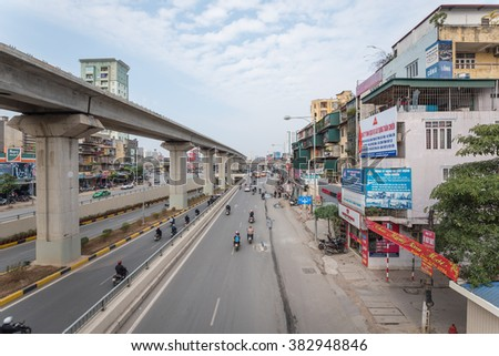 HANOI, VIETNAM â?? FEB 28, 2016:Traffic at the intersection with many types of vehicle such as trucks, cars, buses, motorcycles, bikes and pedestrians on the street,thru tunnel and on overhead highway