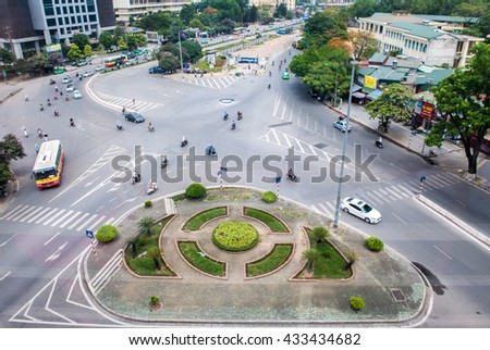 Hanoi, Vietnam - June 4, 2016: Traffic on a crossroads of Hanoi, Vietnam on the morning of the satuday - on the weekends, often better traffic, no congestion phenomenon and not too crowded.