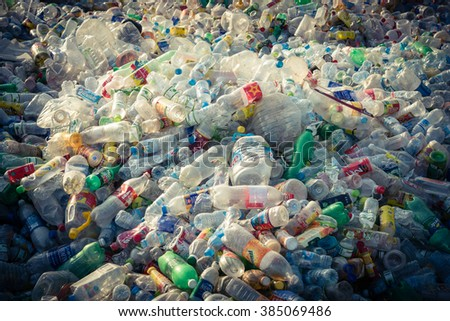 HANOI, VIETNAM-MAR 1, 2016: Close-up view plastic bottles of various drinks in the yard of a company specializing in ecological treatments. Large heap bottles, cans for recycling.Vignette effect added