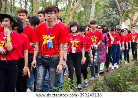 Hanoi, Vietnam - Mar 26, 2016: Vietnamese youth volunteer matching at an event for social community and environment activities outdoor in a country area. - stock photo