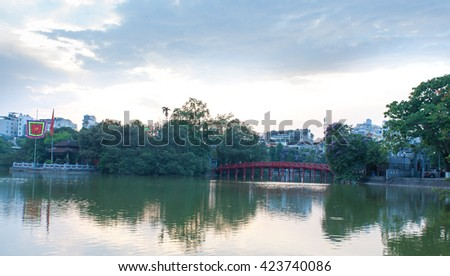Hanoi VIetnam May 20 2016 Hoan Kiem lake panorama view at sunset period with ancient Turtle Tower and the green trees around the lake.The Hoan Kiem Lake is a popular tourist destination.
