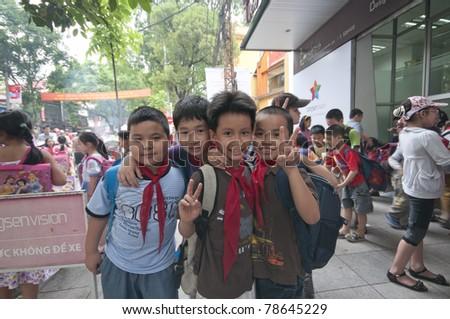 HANOI, VIETNAM - MAY 24: Unidentified school kids after school break in Hanoi, Vietnam on May 24, 2011. Education is free in Vietnam for kids aged 6-11 years old. - stock photo