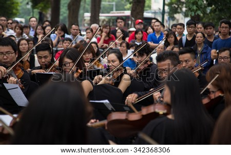 Hanoi, Vietnam - Nov 22, 2015: An outdoor live classic concert music by Asian composers performing on the side walk of an old quarter street in Hanoi capital city.  - stock photo