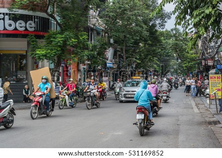 HANOI, VIETNAM - OCTOBER 27, 2016: Traffic in Old Quarter