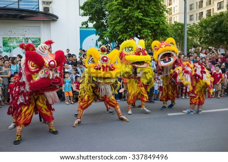 Hanoi, Vietnam - Sep 25, 2015: A show of lion dance at Times City complex in Vietnamese mid autumn festival days