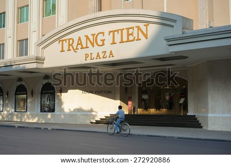 Hanoi, Vietnam - Sep 14, 2014: People moving on street by Trang Tien plaza on Hang Bai street. The plaza is an iconic landmark set at the corner of Hoan Kiem Lake right in the city centre - stock photo