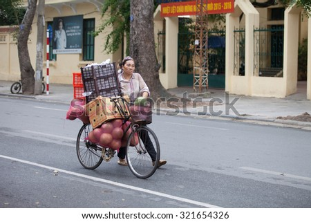 Hanoi, Vietnam, September 26, 2015: Life in Vietnam- Hanoi, Vietnam Street vendors in Hanoi's Old Quarter in early morning.