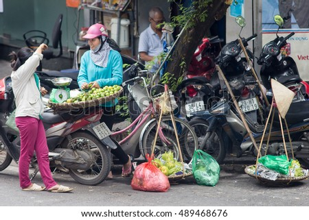 Hanoi Vietnam September 26 2016 .Street vendors in Hanoi's Old Quarter( Pho Co Hanoi). Hanoi, Vietnam, Street vendors sell a lot of things, fruits, flowers, personal items, etc..