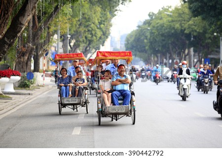 hanoi,vietnam: tourists visit the Hanoi' Old Quater by cyclo on March 14,2016. Cyclo is transportation favorite for visiting hanoi