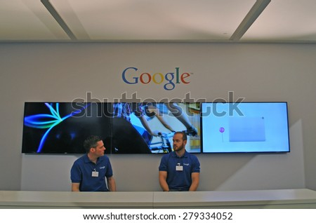 HANOVER, GERMANY, 20 March 2015 - Employees of Google under the Google word brand during Cebit in Hanover. - stock photo