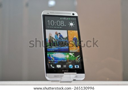 HANOVER, GERMANY, 20 MARCH 2015 - HTC smart phone displayed in the booth of Google at CeBit, the biggest trade fair for information technology in the world. - stock photo