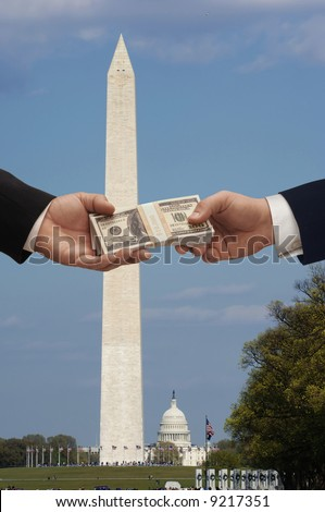 Hanshake in Washington DC with the Washington monument and capitol Hill in the background - stock photo