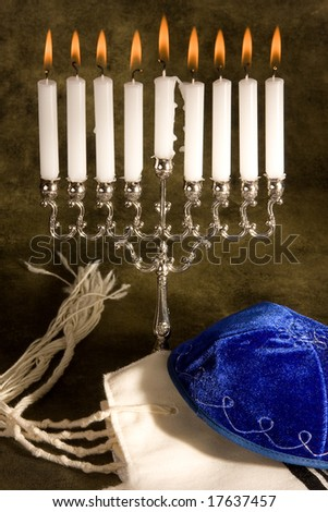 Hanukkah candle-holder, prayer shawl and cap - stock photo