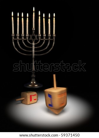 Hanukkah dreidels under a spotlight - stock photo
