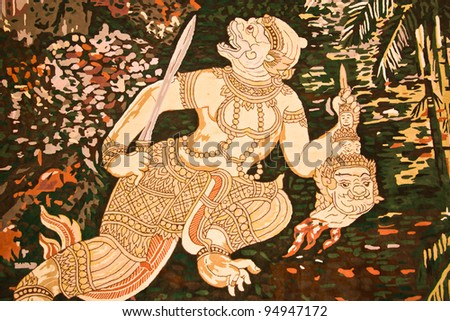 Hanuman painting on the wall. This is typical of Thai traditional art. And No any trademark or restrict matter in this photo. - stock photo