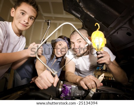 Hapless family of mechanics working on car with all the wrong tools