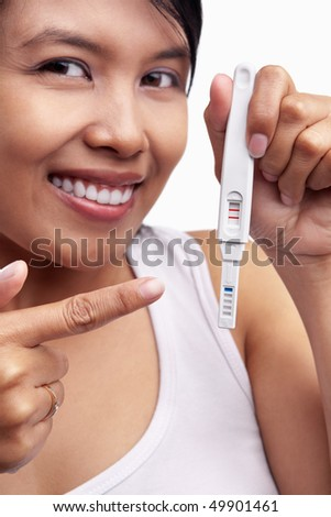 Happily showing pregnancy test