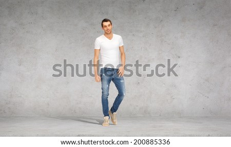 happiness, advertising and people concept - smiling young man in white t-shirt - stock photo