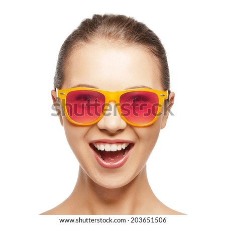 happiness and people concept - portrait of happy teenage girl in shades - stock photo