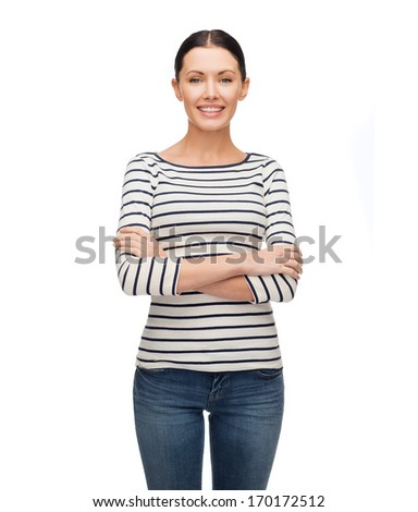 happiness and people concept - smiling girl in casual clothes with crossed arm - stock photo
