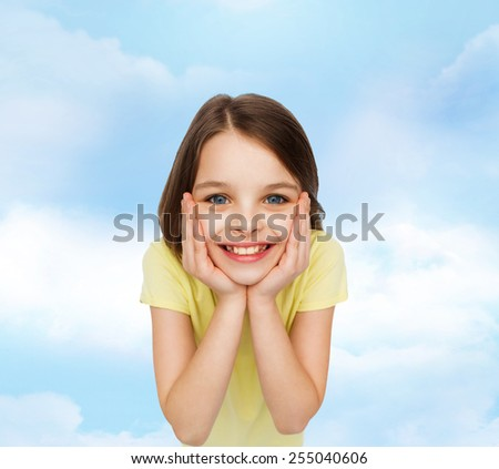 happiness and people concept - smiling little girl holding head over white background - stock photo