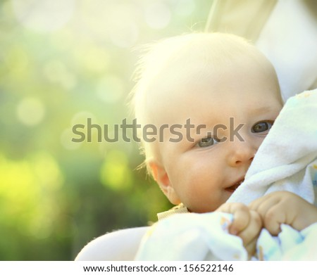 Happiness Baby boy sitting in  the garden.  - stock photo
