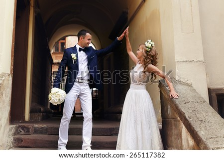 happiness bride and groom giving each other high five - stock photo