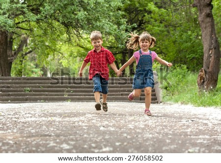 Happiness brother and sister fun outdoor under sunlight - stock photo