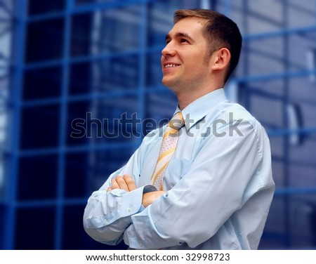 Happiness business men look on business architecture background - stock photo