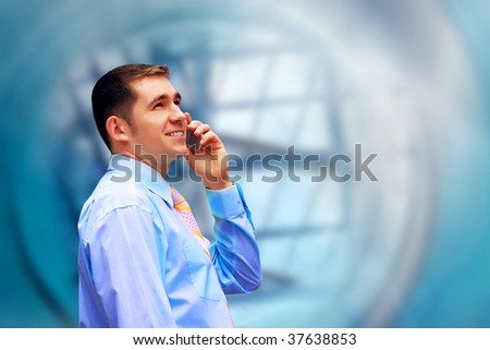 Happiness businessman on blur business architecture background - stock photo