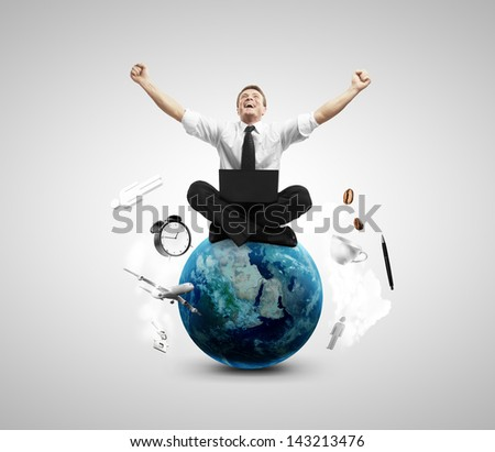 happiness businessman sitting on earth with notebook