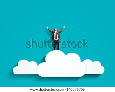 happiness businessman standing on clouds - stock photo