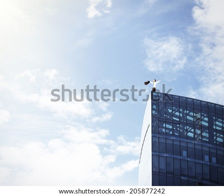 happiness businessman standing on roof of scyscrapper - stock photo