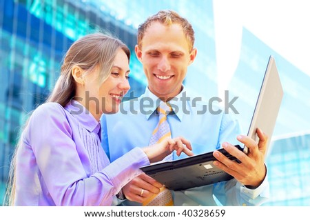 Happiness businessmans with laptop on blur business architecture background - stock photo