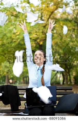 happiness businesswoman throwing paper in the air, outdoor - stock photo